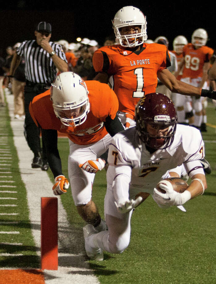 Deer Park wide receiver Josh Rutherford (7) dives for the end zone during a fourth and eight play against La Porte during the first quarter of a high school football game at Bulldog Stadium on Friday, Oct. 19, 2012, in La Porte. The ball was placed on the one-yard line. Photo: J. Patric Schneider, For The Chronicle / © 2012 Houston Chronicle