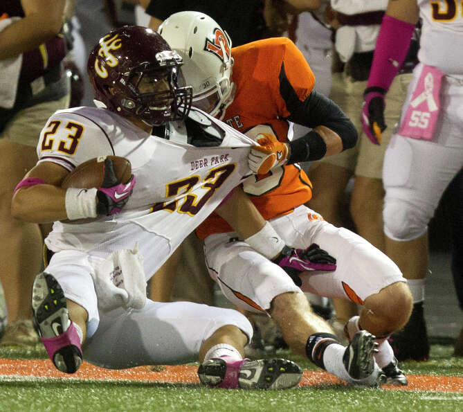 Deer Park running back Noah Cano (23) is brought down by La Porte's Hoza Scott (20) during the first