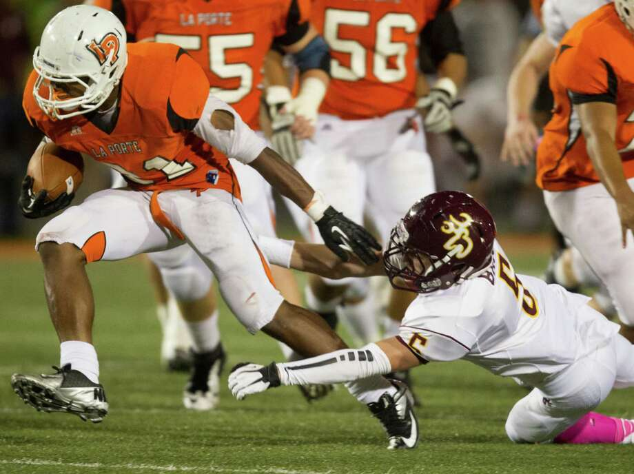 La Porte running back Keith Whitely (21) runs past Deer Parks' Zach Bajula (5) during a punt return in the second quarter of a high school football game at Bulldog Stadium on Friday, Oct. 19, 2012, in La Porte. Photo: J. Patric Schneider, For The Chronicle / © 2012 Houston Chronicle