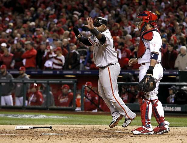 Giants' Pablo Sandoval waves home his teammate Hunter Pence as two runs score in the fourth inning on a Brandon Crawford single, as the San Francisco Giants take on the St. Louis Cardinals in game five of the National League Championship Series, on Friday Oct. 19, 2012 at Busch Stadium , in  St. Louis, Mo. Photo: Michael Macor, The Chronicle