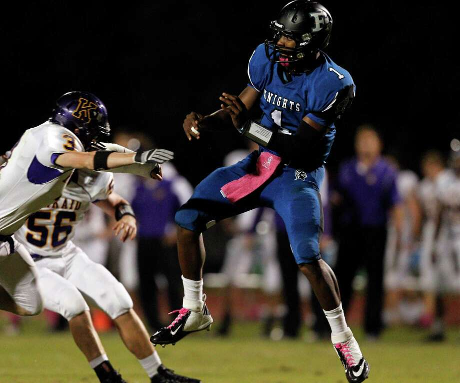 Episcopal quarterback Austin Robinson #1 just releases the ball as he is pressured by Kinkaid's Harris Green #3 during a SPC football game between Kinkaid and Episcopal Friday, October 19, 2012. Photo: Bob Levey, Houston Chronicle / ©2012 Bob Levey