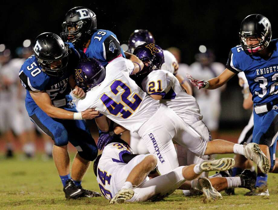 Episcopal wide receiver Lloyd Julian #19 is  brought down by Kinkaid's  Sam Stephens #42 and Paxton Rome #21 along with Barrett Mize #34  during a SPC football game between Kinkaid and Episcopal Friday, October 19, 2012. Photo: Bob Levey, Houston Chronicle / ©2012 Bob Levey