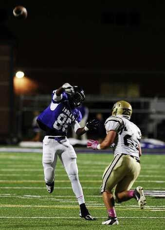 Port Neches- Groves wide receiver Jeremiah Rose passes to Avery Murdock for a touchdown during the Mid County Madness football game with Nederland and PN-G at PN-G High School on Friday, October 19, 2012. Photo taken: Randy Edwards/The Enterprise Photo: Randy Edwards