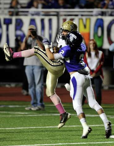 Nederland wide receiver Seth Barrow completes a pass to put Nederland within 10 yards of the goal during the Mid County Madness football game with Nederland and PN-G at PN-G High School on Friday, October 19, 2012. Photo taken: Randy Edwards/The Enterprise Photo: Randy Edwards