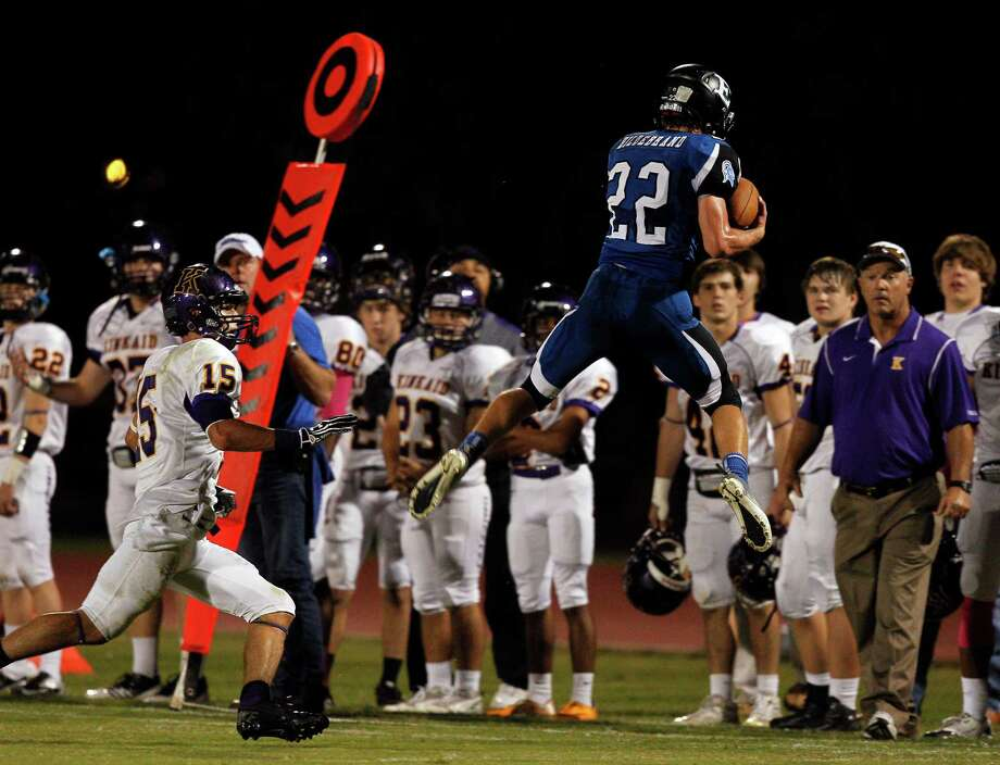 Episcopal's Jeffery Hildebrand #22 can't come down in bounds after intercepting a pass meant for Kinkaid's Macan Wilson #15 during a SPC football game between Kinkaid and Episcopal Friday, October 19, 2012. Photo: Bob Levey, Houston Chronicle / ©2012 Bob Levey