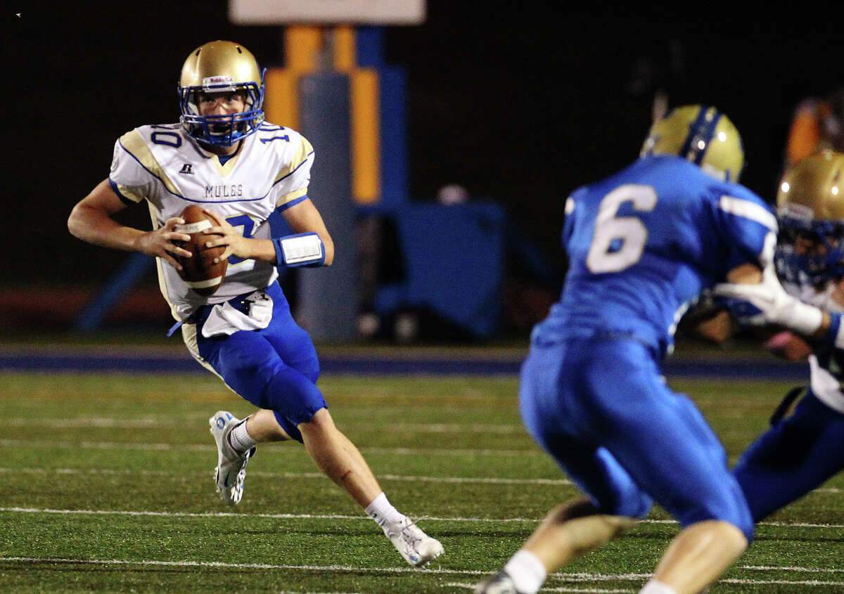 Alamo Heights quarterback Kalen Brockwell (10) runs in for a first half touchdown against Kerrville Tivy in Kerrville on Friday, Oct. 19, 2012.