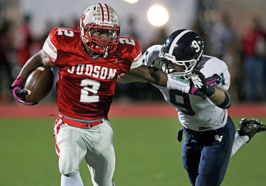 Rocket running back Jarveon Williams almost breaks for clear sailing on his first run from scrimmage but is caught by Hayden Hill as Judson hosts Smithson Valley at Rutledge Stadium  on October 19, 2012. Photo: Tom Reel, Express-News / ©2012 San Antono Express-News