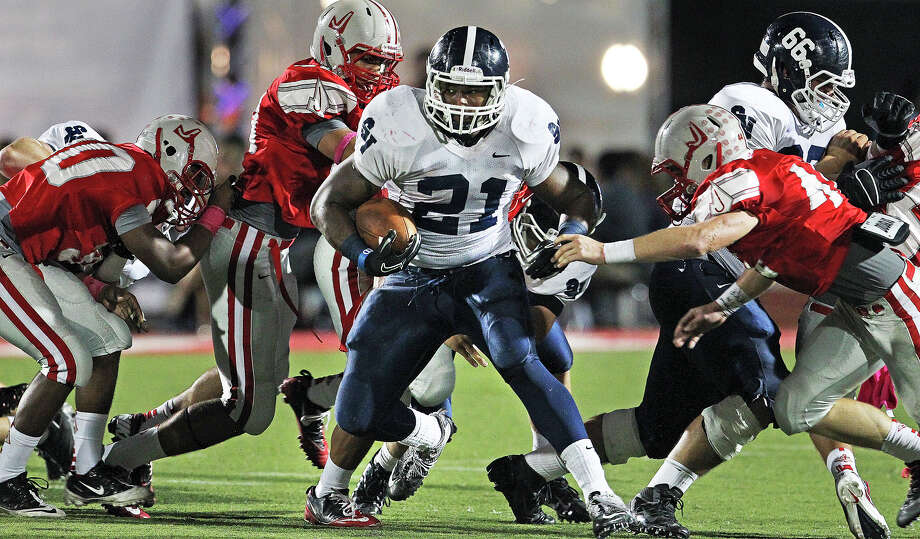 Lawrence Mattison rambles through the middle of the Rocket defense as Judson hosts Smithson Valley at Rutledge Stadium  on October 19, 2012. Photo: Tom Reel, Express-News / ©2012 San Antono Express-News