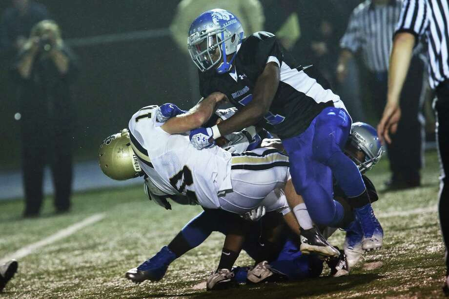 Mike Ross Connecticut Post freelance - Bunnell High School's # 7 Isaiah Arthur Brown gives heavy defensive preasure for a sack on Barlow High School's #10 Jack Shaban during first action on Friday evening. Photo: Mike Ross / Connecticut Post Freelance