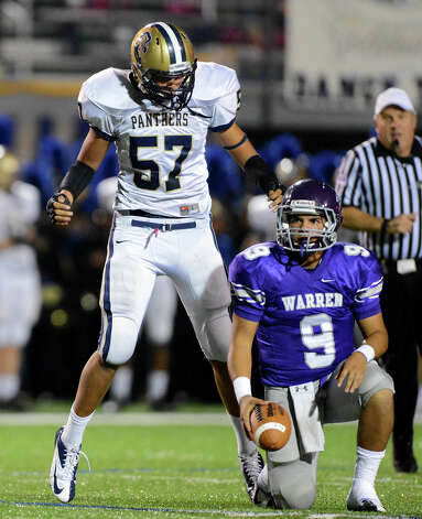 O'Connor's Javier Leyva (57) celebrates after sacking Warren quarterback Ryan Larson (9) during a district football game between the Warren Warriors and the o'Connor Panthers at Farris Stadium in San Antonio, Saturday, October 19, 2012.