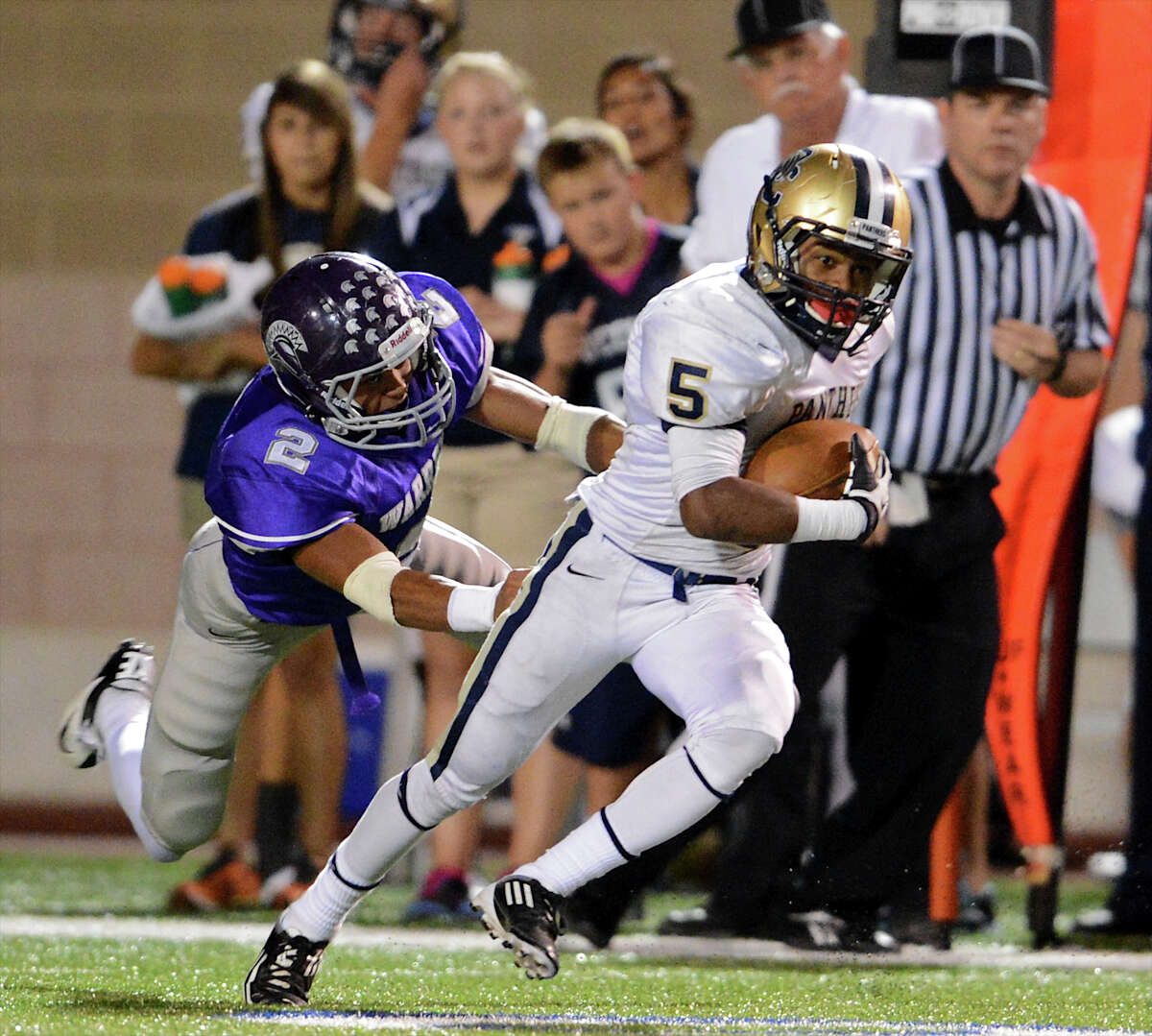 O'Connor's Tre Johnson (5) sprints past Warren's Demonte Butler (2) during a district football game between the Warren Warriors and the o'Connor Panthers at Farris Stadium in San Antonio, Saturday, October 19, 2012. John Albright / Special to the Express-News.