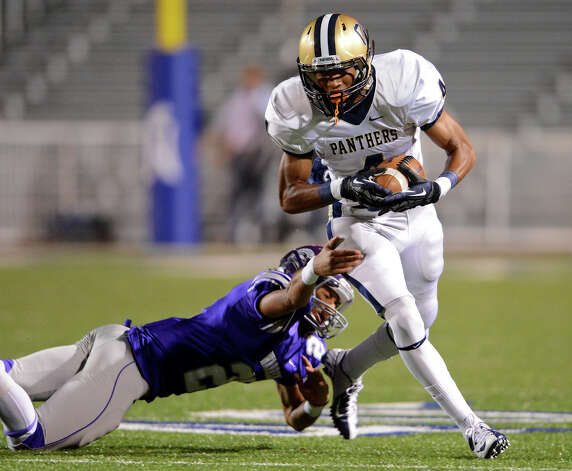 O'Connor's Nate Phillips (4) tries to get past Warren's Luis Mercer (27) during a district football game between the Warren Warriors and the o'Connor Panthers at Farris Stadium in San Antonio, Saturday, October 19, 2012.