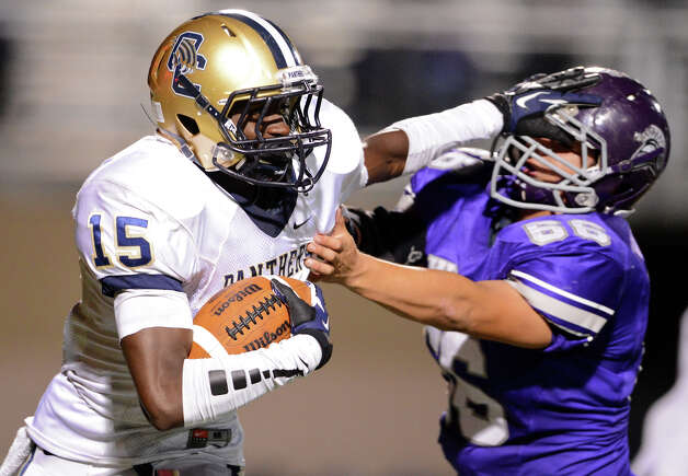 O'Connor's Alan Wright (15) stiff-arms Warren's Daniel Blanco (66) during a district football game between the Warren Warriors and the o'Connor Panthers at Farris Stadium in San Antonio, Saturday, October 19, 2012.