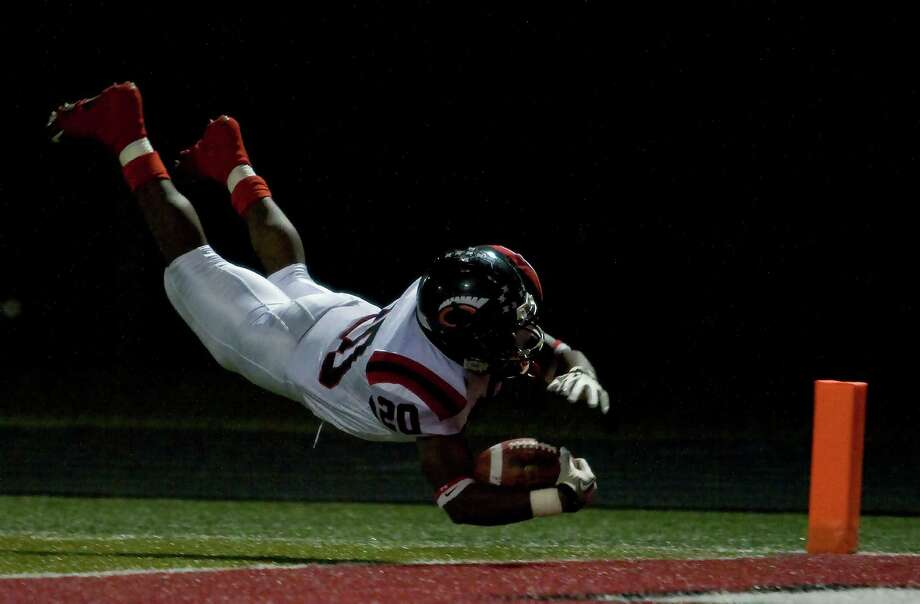 Coldspring's Trey Cooper (20) drives for the endzone at Falcon Stadium on Friday, Oct. 19, 2012, in Huffman. Photo: Joe Buvid, For The Chronicle / © 2012 Joe Buvid
