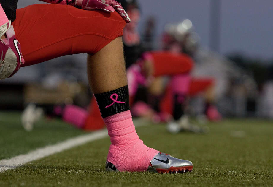 Huffman Hargrave players wear pink in support of breast cancer awareness month at Falcon Stadium on Friday, Oct. 19, 2012, in Huffman. Photo: Joe Buvid, For The Chronicle / © 2012 Joe Buvid