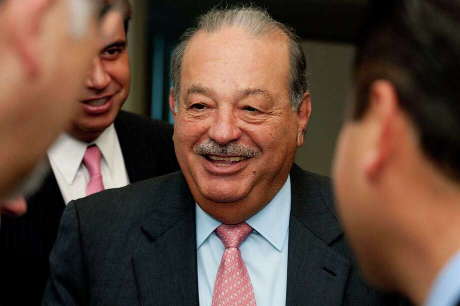 Mexican billionaire Carlos Slim, chariman emeritus of America Movil Sab de CV, which controls 70 percent of Mexico's mobile-phone business, chats with attendees following a news conference in Mexico City, Mexico, on Tuesday, Jan. 31, 2012. Slim said the prices charged by his phone companies in Mexico are among the world's lowest. Photographer: Susana Gonzalez/Bloomberg *** Local Caption *** Carlos Slim Photo: Susana Gonzalez / © 2012 Bloomberg Finance LP