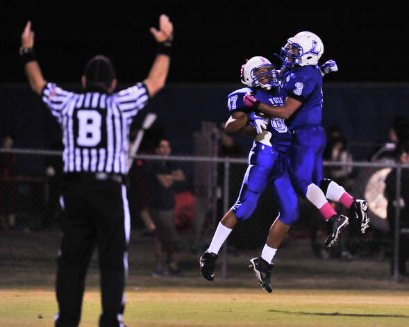 Lanier's Steven Horton (87) and Isaac Cervantes celebrate Horton's second quarter touchdown versus Brennan Friday night. Photo: Robin Jerstad, Express-News