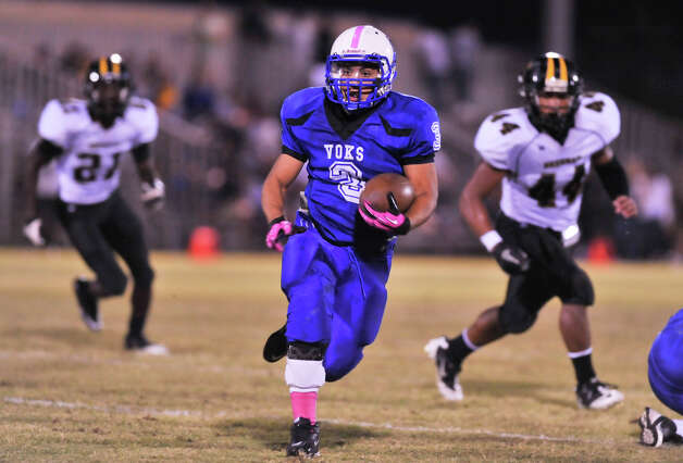 Lanier's Isaac Cervantes looks for running room versus Brennan Friday night. Photo: Robin Jerstad, Express-News