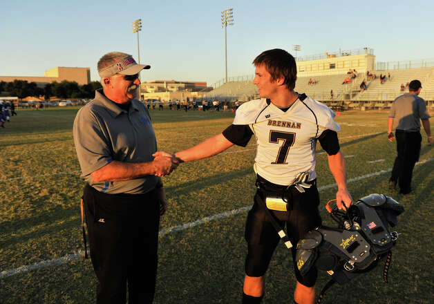 Lanier coach Don Gatian talks with his son Dillon who plays for his opponent, Brennan prior to Friday's game. Photo: Robin Jerstad, Express-News