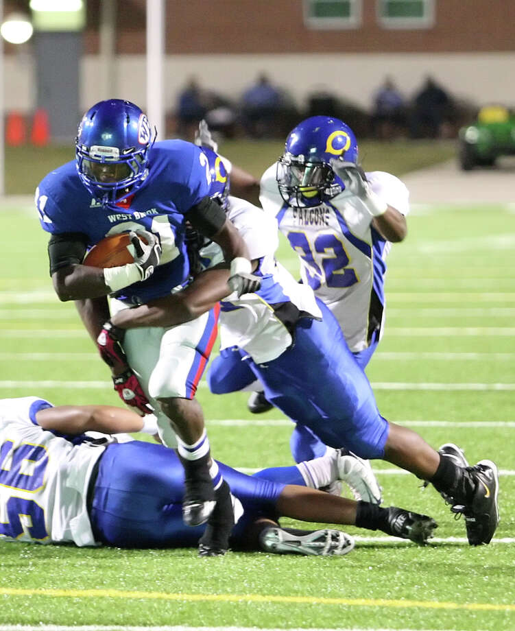 West Brook running back Cameron McBride tries to break a tackle during the game against Channelview Friday at the Beaumont ISD Thomas Center. (Special to the Enterprise/Matt Billiot)