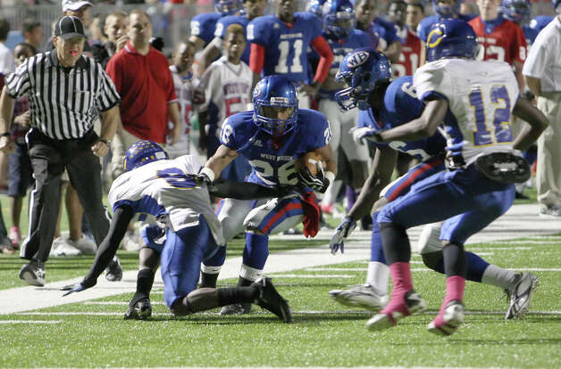 West Brook running back Stephen Wycoff, No. 28, is tackled by Jaime Caddell, No. 8, during the game against Channelview Friday at the Beaumont ISD Thomas Center. (Special to the Enterprise/Matt Billiot)