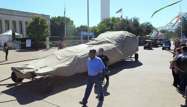 The covered remains of Big Tex are rolled away at the State Fair of Texas, Friday, Oct. 19, 2012, in Dallas. The iconic structure was destroyed Friday when flames engulfed his 52-foot-tall frame. Photo: LM Otero, Associated Press / AP