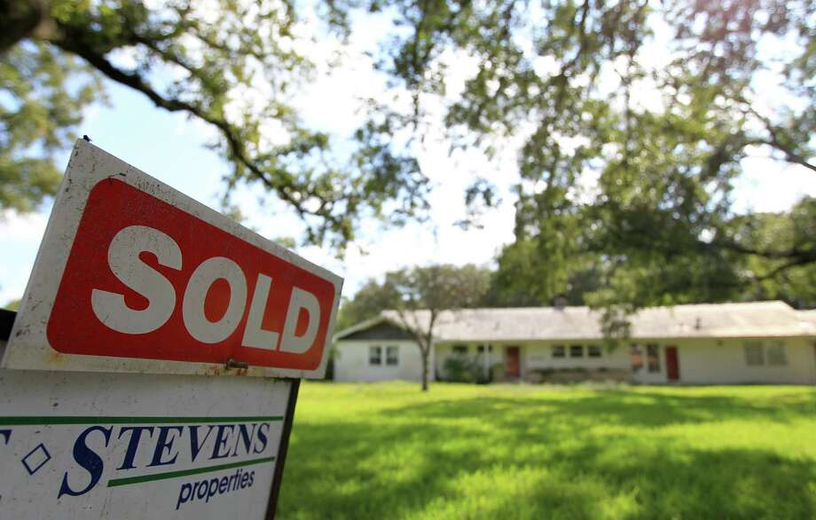 A house has been sold in Bellaire. Buyers in the Houston area closed on 5,379 single-family homes in October, up from 4,054 at the same time last year. Photo: Karen Warren, Staff / © 2012  Houston Chronicle