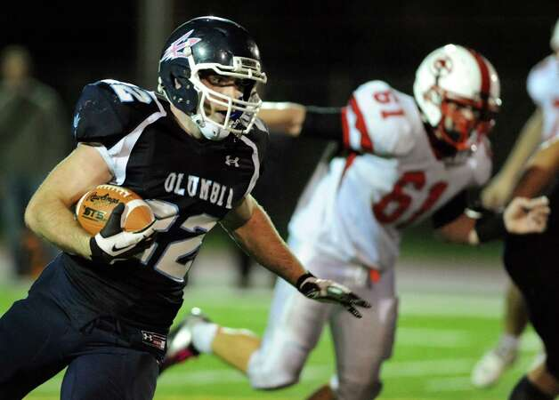 Columbia's Chris Smith (22), left, runs the ball during their football game against Guilderland on Friday, Oct. 19, 2012, in East Greenbush, N.Y. (Cindy Schultz / Times Union) Photo: Cindy Schultz / 00019738A
