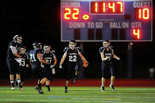 Columbia's Chris Smith (22), center, celebrates a touchdown with teammates during their football game against Guilderland on Friday, Oct. 19, 2012, in East Greenbush, N.Y. (Cindy Schultz / Times Union) Photo: Cindy Schultz / 00019738A