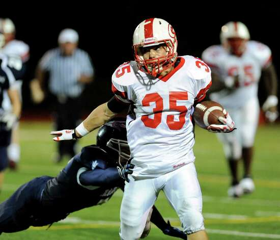 Guilderland's Marcus Knodler (35), center, dodges a tackle from Columbia's Matt Briggs (7), left, during their football game on Friday, Oct. 19, 2012, at Columbia High in East Greenbush, N.Y. (Cindy Schultz / Times Union) Photo: Cindy Schultz / 00019738A