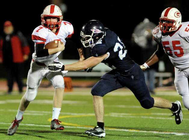 Guilderland's quarterback Frank Gallo (7), left, runs the ball as Columbia's Chris Smith (22), center, defends during their football game on Friday, Oct. 19, 2012, at Columbia High in East Greenbush, N.Y. (Cindy Schultz / Times Union) Photo: Cindy Schultz / 00019738A