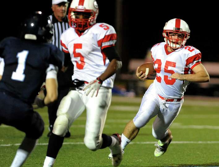 Guilderland's Stephen Polsinelli (25), right, runs the ball during their football game against Colum