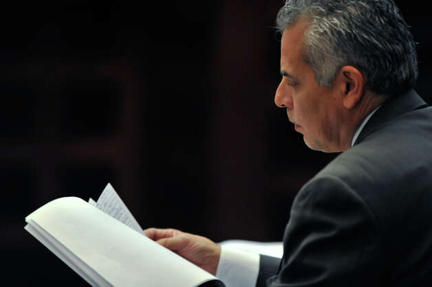 Defense attorney Joel Perez looks over a document as the sentencing phase of the  capital murder trial of James Morrison begins Monday, Oct. 15, 2012. Photo: Robin Jerstad, For The Express-News