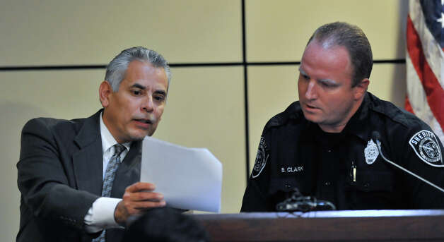 Defense attorney Joel Perez discusses a document  with Deputy Brian Clark on Monday, Oct. 15, 2012. Clark is a witness in the sentencing phase of the  capital murder trial of James Morrison. Photo: Robin Jerstad, For The Express-News