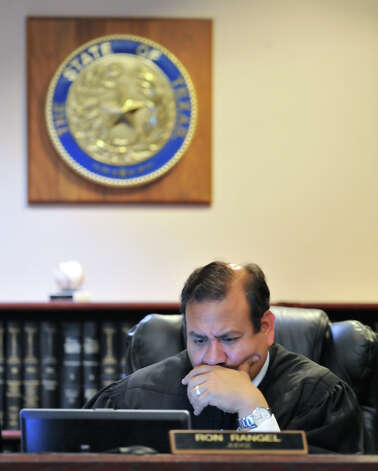 Judge Ron Rangel of the 379 District Court studies a computer screen as the sentencing phase of convicted capital murderer James Morrison's trial begins Monday, Oct. 15, 2012. Photo: Robin Jerstad, For The Express-News