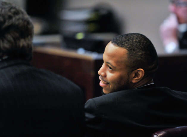 James Morrison, convicted last week of capital murder, smiles while talking with his attorney, Mark McKay, as the sentencing phase of his conviction begins Monday, Oct. 15, 2012. Photo: Robin Jerstad, For The Express-News