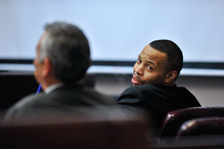 James Morrison, convicted last week of capital murder, looks over his shoulder as the sentencing phase of his conviction begins Monday, Oct. 15, 2012. Photo: Robin Jerstad, For The Express-News