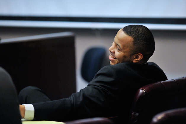 James Morrison, convicted last week of capital murder, laughs with his attorney Joel Perez as the sentencing phase of his conviction begins Monday, Oct. 15, 2012. Photo: Robin Jerstad, For The Express-News