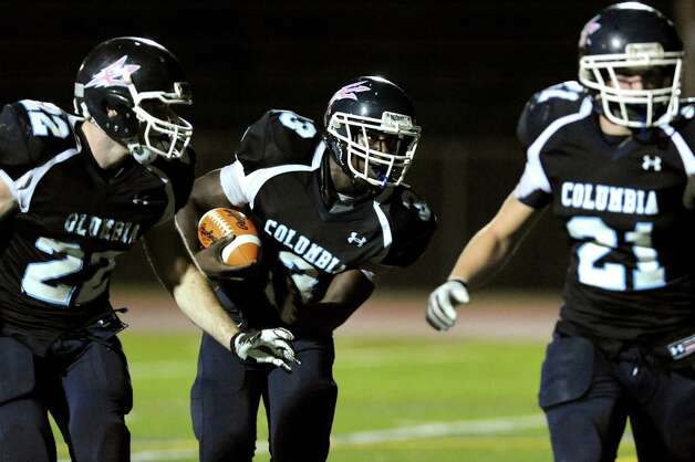 Columbia's Kenny Mathieu (3), center, runs a two-point conversion during their football game against Guilderland on Friday, Oct. 19, 2012, in East Greenbush, N.Y. (Cindy Schultz / Times Union) Photo: Cindy Schultz / 00019738A