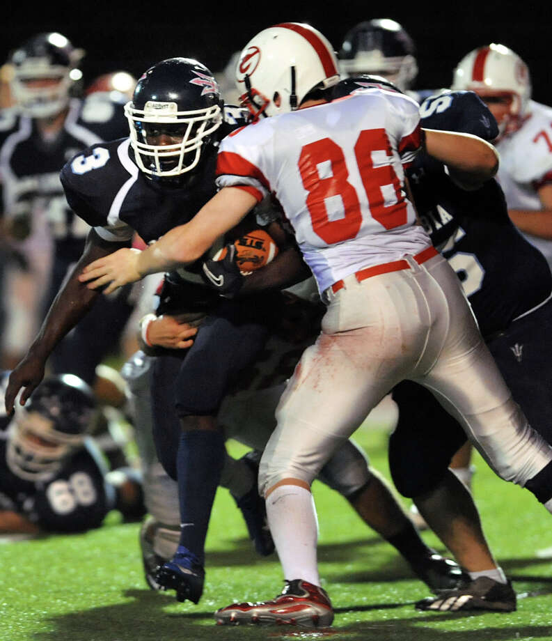 Columbia's Kenny Mathieu (3), left, runs the ball as Guilderland's Patrick Verrelli (86) defends during their football game on Friday, Oct. 19, 2012, in East Greenbush, N.Y. (Cindy Schultz / Times Union) Photo: Cindy Schultz / 00019738A