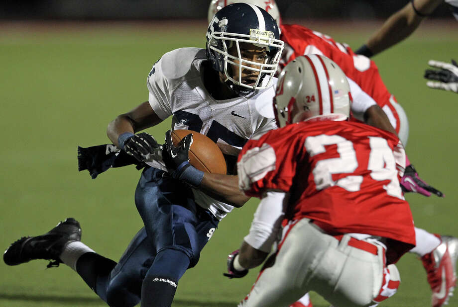 Cameron Jones splits defenders on a run in the first half as Judson hosts Smithson Valley at Rutledge Stadium  on October 19, 2012. Photo: Tom Reel, Express-News / ©2012 San Antono Express-News