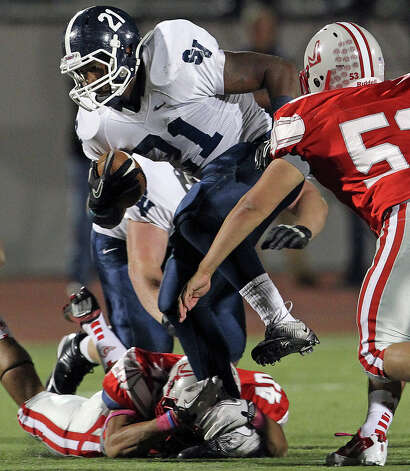 lawrence Mattison shakes a tackler as Judson hosts Smithson Valley at Rutledge Stadium  on October 19, 2012. Photo: Tom Reel, Express-News / ©2012 San Antono Express-News