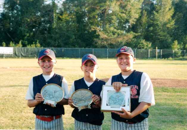 A 12-year-old Johnny Manziel (left) stands with members of his Tyler Indians baseball team. J.B. Moss (center) is an A&M baseball player, and Jimmy Landes plays football and baseball at Baylor.  Michelle Manziel / Courtesy photo