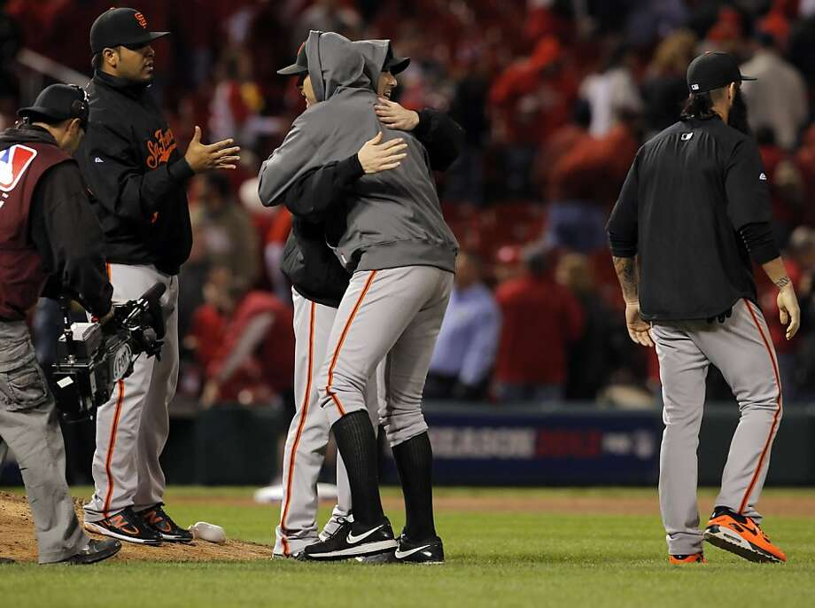 After pitching the Giants to a 5-0 victory that kept them alive, Barry Zito gets a hug from fellow pitcher Tim Lincecum. Photo: Carlos Avila Gonzalez, The Chronicle