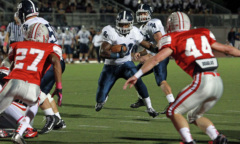 Lawrence Mattison springs toward a touchdown in the first quarter as Judson hosts Smithson Valley at Rutledge Stadium  on October 19, 2012. Photo: Tom Reel, Express-News / ©2012 San Antono Express-News