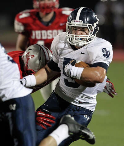 Joey Bochat runs through the middle for the Rangers as Judson hosts Smithson Valley at Rutledge Stadium  on October 19, 2012. Photo: Tom Reel, Express-News / ©2012 San Antono Express-News