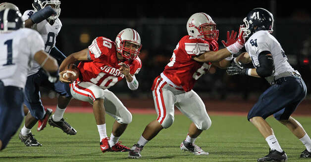 Rayjohn Austin-Ramsey looks for running room for the Rockets as Judson hosts Smithson Valley at Rutledge Stadium  on October 19, 2012. Photo: Tom Reel, Express-News / ©2012 San Antono Express-News