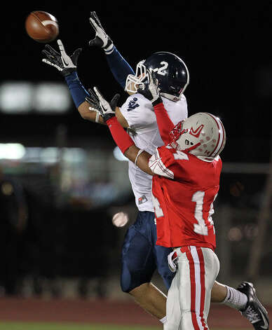 Clayton lauderdale tries to pull in a pass in the second half as Judson hosts Smithson Valley at Rutledge Stadium  on October 19, 2012. Photo: Tom Reel, Express-News / ©2012 San Antono Express-News