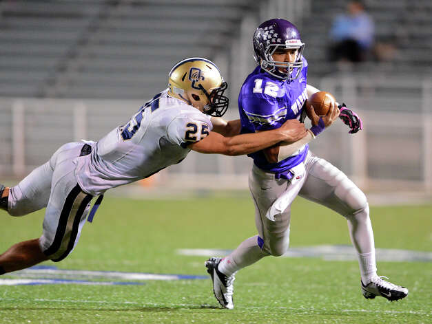 Warren's Jordan Sneed (12) is tackled by O'Connor's Luke Farmer (25) during a district football game between the Warren Warriors and the o'Connor Panthers at Farris Stadium in San Antonio, Saturday, October 19, 2012.