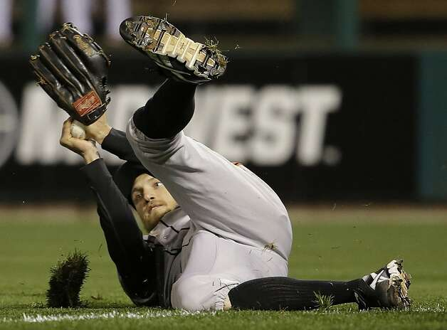 San Francisco Giants right fielder Hunter Pence makes a diving catch on a ball hit by St. Louis Cardinals' Pete Kozma during the fifth inning of Game 5 of baseball's National League championship series, Friday, Oct. 19, 2012, in St. Louis. (AP Photo/David J. Phillip) Photo: David J. Phillip, Associated Press